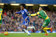 Willian of Chelsea breaks past Nathan Redmond of Norwich City  .Barclays Premier league match, Chelsea v Norwich city at Stamford Bridge in London on Saturday 21st November 2015.<br /> pic by John Patrick Fletcher, Andrew Orchard sports photography.
