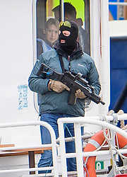 © Licensed to London News Pictures. 19/03/2017. London, UK. A tourist boat taken hostage by people playing armed terrorists (pictured holding guns), in an ant-terror training exercise takes place on The River Thames in  London. It is the first time that an exercise of this type has taken place on the river. Photo credit: Ben Cawthra/LNP