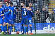 Callum Camps and Kgosi Nthle celebrate at the final whistle during the EFL Sky Bet League 1 match between Rochdale and Shrewsbury Town at Spotland, Rochdale, England on 9 March 2019.