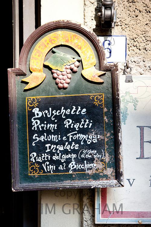 Chalk board restaurant menu of La Bottega di Giovannino with local specialities on offer in Radda-in-Chianti, Tuscany, Italy