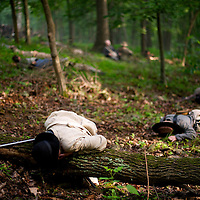 Confederate and Union troops lay dead after a reenactment of The Battle of Little Roundtop during the Blue Gray Alliance events marking the 150th anniversary of the Battle of Gettysburg, in Gettysburg, Pennsylvania June 30, 2013.
