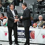 Besiktas's coach Ergin Ataman (L) and Anadolu Efes's coach Ufuk Sarica (R) during their Turkish Basketball league derby match Besiktas between Anadolu Efes at the BJK Akatlar Arena in Istanbul Turkey on Saturday 31 December 2011. Photo by TURKPIX