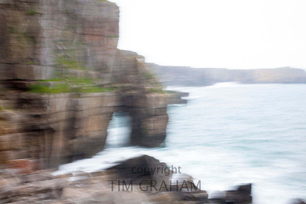Abstract blur of limestone cliffs and stack at St. Govan's Head, Pembrokeshire, South West Wales