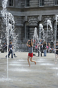 As temperatures rise in Britain a  young girl plays in the fountains at Somerset House, central London.