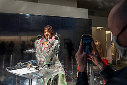 © Licensed to London News Pictures. 17/09/2021. LONDON, UK. A man photographs Paula Sello and Alissa Aulbekova's fashion house Auroboros showcase, a real-time growing couture gown worn by Ai-Da, the world's first artist robot, that will grow and fall apart during the festival whilst Ai-Da draws a self-portrait that can be experienced virtually. Launch of this year's London Design Festival at the V&A Museum in South Kensington.  Installations, projects, performances and events explore design thinking in the challenge of climate change. Photo credit: Stephen Chung/LNP
