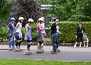 © Licensed to London News Pictures. 21/07/2012. London, UK A group of girls enjoy a rollerblading lesson. People enjoy the warm weather in Battersea Park today 21st July 2012. Photo credit : Stephen Simpson/LNP