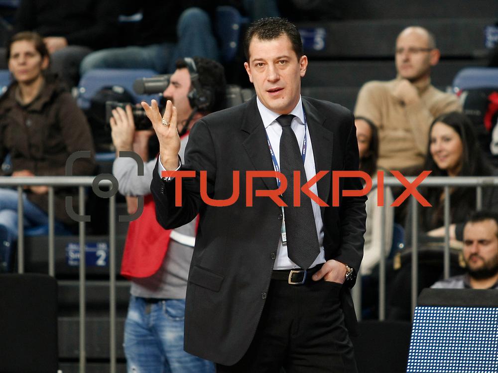 Anadolu Efes's coach Ufuk Sarica during their Turkish Basketball League match Anadolu Efes between Erdemir at Arena in Istanbul, Turkey, Wednesday, January 28, 2012. Photo by TURKPIX
