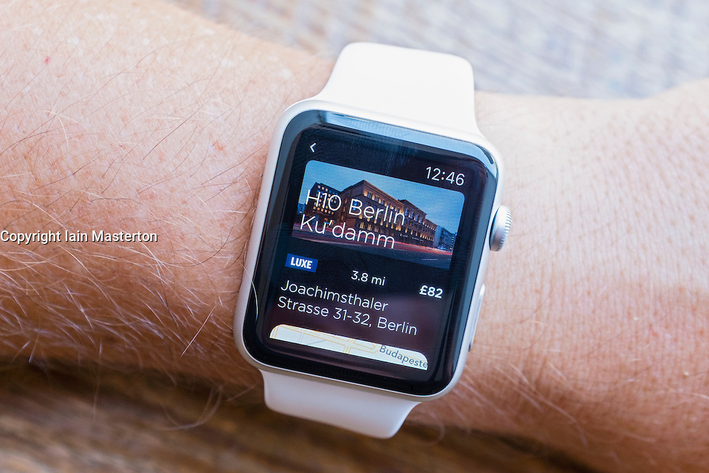 Travel app showing hotel reviews and locations in Berlin on an Apple Watch