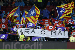 Barcelona supporters wave flags in support for Catalan independence in the stands. Now or never is text on banner during the UEFA Champions League group D match between FC Barcelona and Olympiacos on October 18, 2017  at the Camp Nou stadium in Barcelona, Spain.