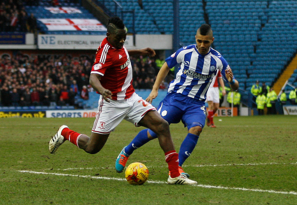 Middlesbrough's Kenneth Omeruo (L) and Sheffield Wednesday's Lewis McGugan in action during todays match  <br /> <br /> Photographer Jack Phillips/CameraSport<br /> <br /> Football - The Football League Sky Bet Championship - Sheffield Wednesday v Middlesbrough - Saturday 28th February 2015 - Hillsborough - Sheffield<br /> <br /> © CameraSport - 43 Linden Ave. Countesthorpe. Leicester. England. LE8 5PG - Tel: +44 (0) 116 277 4147 - admin@camerasport.com - www.camerasport.com