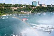 Tourists soak in the mist of Niagara Falls aboard the Maid of the Mist, Buffalo, New York, USA.