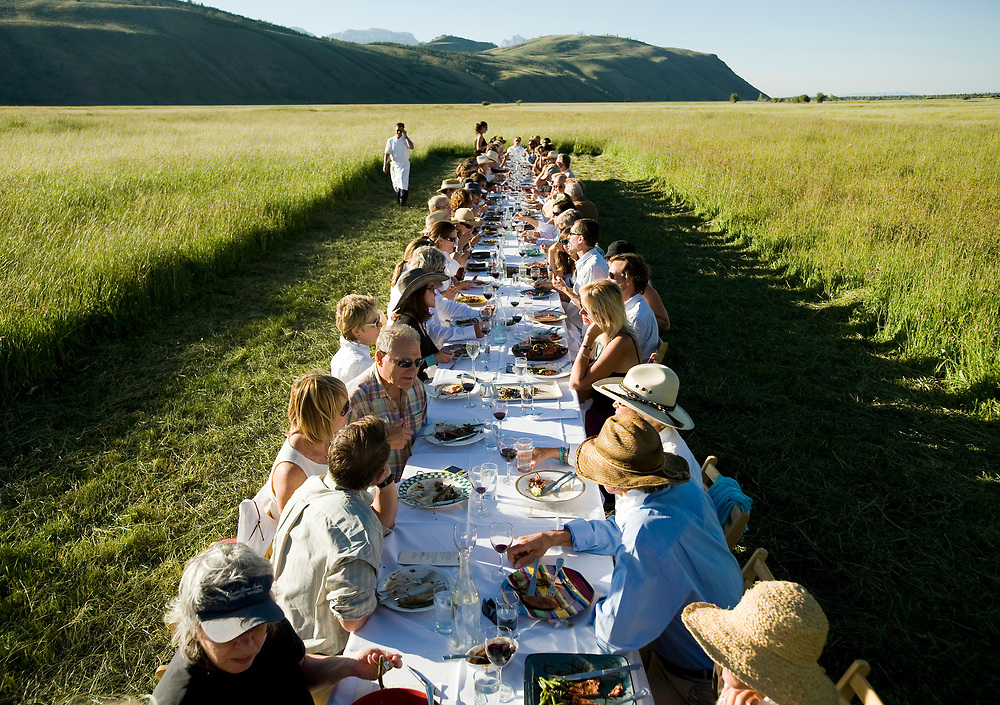 PRICE CHAMBERS / NEWS&GUIDE<br /> Outstanding in the Field visits the Mead Ranch in Spring Gulch on Thursday, July 22, 2010. Snake River Grill Chef Jeff Drew coordinates a gourmet, five-course meal enjoyed by the 70-plus guests at a long table set in the ranch field. Pam Niner of Niner Wine Estates provides some of their latest favorites.