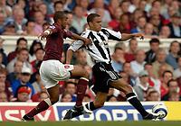 Photo: Henry Browne.<br /> Arsenal v Newcastle Utd. Barclaycard Premiership.<br /> 14/08/2005.<br /> Kieron Dyer of Newcastle holds off Ashley Cole of Arsenal.