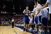 Kristaps Porzingis #46 of the New York Knicks high-fives teammates against the San Antonio Spurs during an NBA Summer League game in Las Vegas, Nevada on July 11, 2015. (Cooper Neill for The New York Times)