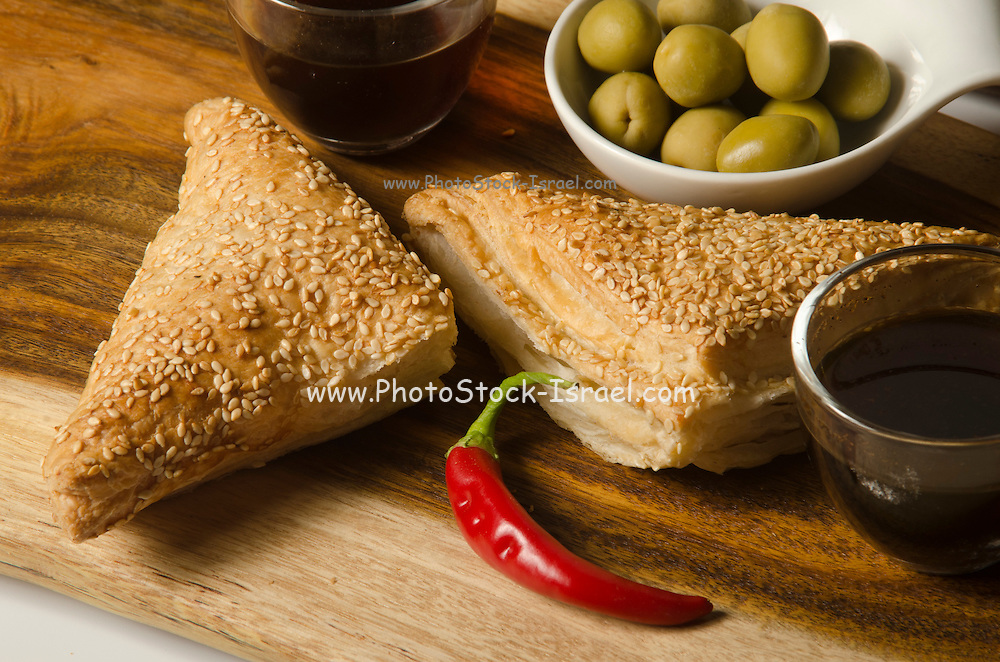 Borek (Also Burek) a Turkish pastry filled with cheese or potato or mushroom with green olives