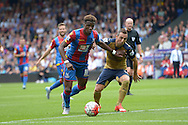 Wilfried Zaha of Crystal Palace goes past Santi Cazorla of Arsenal. Barclays Premier league match, Crystal Palace v Arsenal at  Selhurst Park in London on Sunday 16th August 2015.<br /> pic by John Patrick Fletcher, Andrew Orchard sports photography.