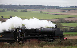 © Licensed to London News Pictures. 07/03/2014. Hampshire, UK. The steam locomotive '31806 - U Class' on the Watercress Line today, 7th March 2014, which is the first day of the 'spring steam gala' on the Watercress Line. The railway line, operated by Mid Hants Railway Ltd, passes between Alresford and Alton in Hampshire. The line is named after its use in the past for transporting freshly cut watercress from the beds surrounding Alresford to London. Photo credit : Rob Arnold/LNP