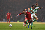 Dedryck Boyata sends Lewis Ferguson flying during the Betfred Cup Final between Celtic and Aberdeen at Hampden Park, Glasgow, United Kingdom on 2 December 2018.