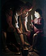 'St Joseph the Carpenter'.  St Joseph in his workshop with the boy Jesus who is holding a candle. Artist, G De La Tour. Musee de Beaux Arts, Besancon.
