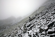 Snow and fog blanket the slopes along stage 11 of the Walker's Haute Route, between Zinal and Gruben, Switzerland.