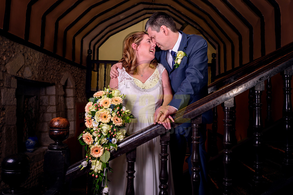 newlyweds on staircase
