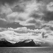 Three weeks aboard the Kong Harald. Hurtigruten, the Coastal Express. Norvegian landscape near Alesund and the Geirangerfjord. White snow on the mountains.