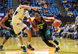 Jan 21, 2019; Morgantown, WV, USA; Baylor Bears guard Devonte Bandoo (2) drives during the first half against the West Virginia Mountaineers at WVU Coliseum. Mandatory Credit: Ben Queen-USA TODAY Sports