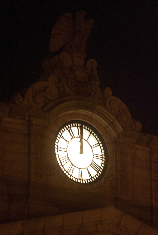 Boston, MA 12/08/2011.The clock outside South Station strikes midnight, signaling the city's deadline for the Occupy Boston protestors to vacate Dewey Square..Alex Jones / www.alexjonesphoto.com