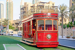 New Dubai Trolley (San Francisco style hydrogen fuel cell powered tourist tram) travelling along street in Dubai United Arab Emirates
