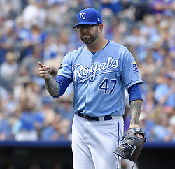August 24, 2017 - Kansas City, MO, USA - Kansas City Royals relief pitcher Peter Moylan points to catcher Drew Butera after ending the top of the seventh with a double play on the Colorado Rockies during Thursday's baseball game at Kauffman Stadium in Kansas City, Mo. (Credit Image: © John Sleezer/TNS via ZUMA Wire)