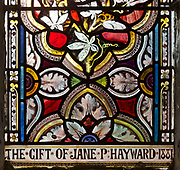 Stained glass window church of Saint Nicholas, Wilsford, Wiltshire, England, UK ornamental floral pattern circa 1880 by ward and Hughes