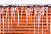 Icicles hanging from the eve of a cabin, June Lake, California