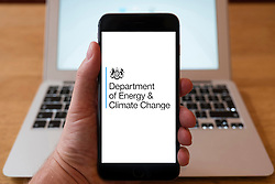 Using iPhone smartphone to display logo of Department of Energy and Climate Change, UK Government