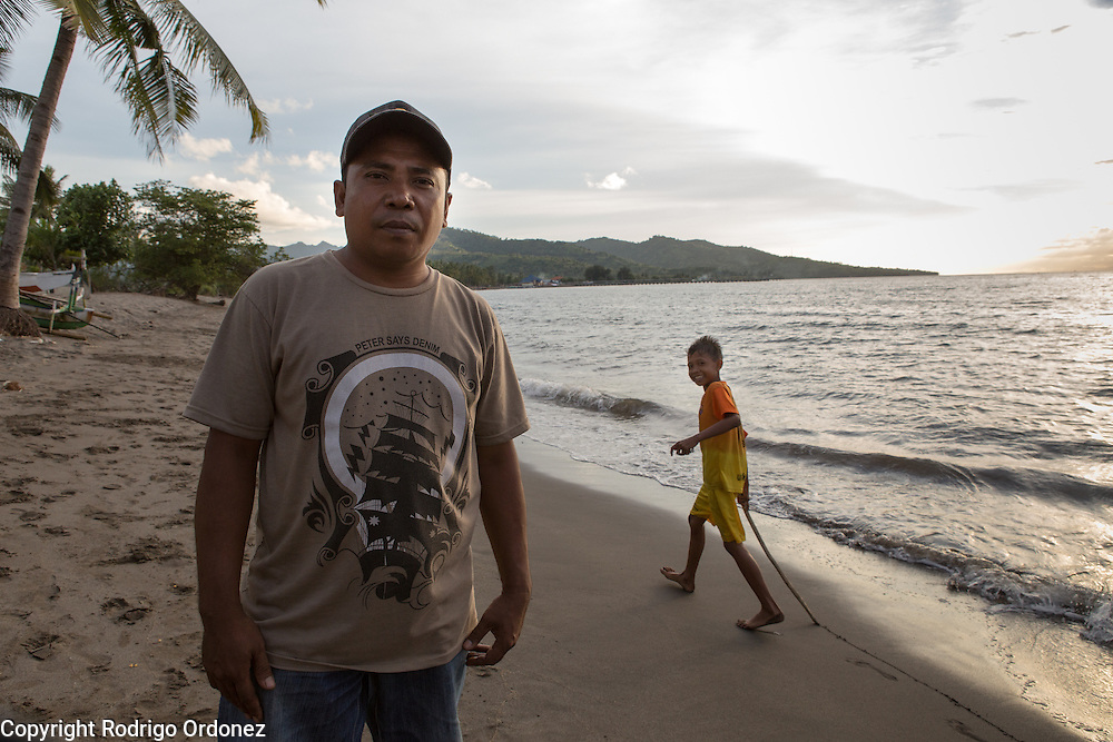 Sriyudin, 41, poses for a photograph in Muara Putat beach, Pemenang Timur, Pemenang subdistrict, North Lombok district, West Nusa Tenggara province, Indonesia. He is a fisherman and also the head of the subvillage. Last January (2013) a tidal wave hit the beach and flooded the land, including his rice paddy of 1.5 hectares which became infertile.