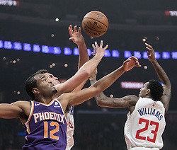 November 28, 2018 - Los Angeles, California, U.S - T.J. Warren #12 of the Phoenix Suns battles for the ball with Danilo Gallinari #8 and  Lou Williams #23 of the Los Angeles Clippers during their NBA game on  Wednesday November 28, 2018 at the Staples Center in Los Angeles, California.  Clippers defeat Suns, 115-99. (Credit Image: © Prensa Internacional via ZUMA Wire)