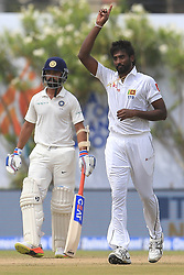 July 27, 2017 - Galle, Sri Lanka - Sri Lankan cricketer Nuwan Pradeep(R) celebrates after taking a wicket during the 2nd Day's play in the 1st Test match between Sri Lanka and India at the Galle International cricket stadium, Galle, Sri Lanka on Thursday 27 July 2017  (Credit Image: © Tharaka Basnayaka/NurPhoto via ZUMA Press)
