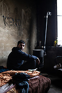 An Algeria Berber migrant is seen in a squat near the town of Velika Kladusa, Bosnia Herzegovina, a dozen Algerians are living in an abandoned factory, the trying to reach Europe following a strange path thru Turkey, Greece and Albania. They are now stuck in Bosnia waiting the right weather condition to attempt to cross the border. Velika Kladusa, January 29, 2021