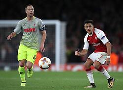 Arsenal's Alexis Sanchez (right) and FC Koln's Mathias Lehmann during the Europa League match at the Emirates Stadium, London.