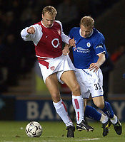 Photo. Matthew Lewis.<br />Leicester City v Arsenal. FA Barclaycard Premiership. 06/12/2003.<br /><br />Arsenal's Dennis Bergkamp holds off Leicester's Ben Thatcher.