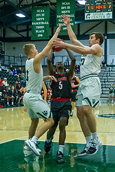 BLOOMINGTON, IL - November 12: Cory Noe and Alex O'Neill block Chanz Aldridge during a college basketball game between the IWU Titans  and the Blackburn Beavers on November 12 2019 at Shirk Center in Bloomington, IL. (Photo by Alan Look)