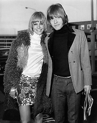 Dec. 3, 1966 - London, England, U.K. - Rolling Stones guitarist BRIAN JONES with girlfriend ANITA PALLENBERG at Heathrow Airport. Little did the Rolling Stones know how apt their name - inspired by the title of a Muddy Waters song, 'Rollin' Stone' - would turn out to be. Formed in 1962, they are the longest-lived continuously active group in rock and roll history.  (Credit Image: © Keystone Press Agency/Keystone USA via ZUMAPRESS.com)