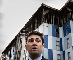 """© Licensed to London News Pictures. 16/11/2019. Bolton, UK. Mayor of Manchester ANDY BURNHAM at the site of the blaze . Firefighters work at the scene where a fire broke out overnight (15th/16th November 2019) at a block of flats known as """" The Cube """" , in Bolton Town Centre . At least two people are known to have been treated by paramedics at the scene of the six-story block , which is occupied by students of the University of Bolton . Photo credit: Joel Goodman/LNP"""