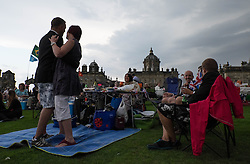 © Licensed to London News Pictures.22/08/15<br /> Castle Howard, North Yorkshire, UK. <br /> <br /> ADRIAN and NICOLA ADAMSON from Beverley dance to the music as hundreds of people attend the 25th anniversary of the Castle Howard Proms event near York. The theme of the event this year is a commemoration of the 75th anniversary of the Battle of Britain and the 70th anniversary of VE day and brings an evening of classic musical favourites celebrating Britishness to the lawns of Castle Howard.<br /> <br /> Photo credit : Ian Forsyth/LNP