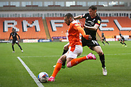 Blackpool forward Keshi Anderson (8) clears fromLincoln City midfielder Conor McGrandles (18) during the EFL Sky Bet League 1 match between Blackpool and Lincoln City at Bloomfield Road, Blackpool, England on 3 October 2020.
