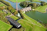 Nederland, Friesland, Gemeente Lemsterland, 10-10-2014; Lemmer, Tacozijl. Ir. D.F. Woudagemaal met bezoekerscentrum.. Het stoomgemaal staat op de Unesco Werelderfgoedlijst en is het grootste nog in bedrijf zijnde stoomgemaal ter wereld. Bij extreem hoge waterstand doet het gemaal nog dienst en helpt om de waterstand van het Friese boezem op peil te houden. Sinds 1967 is het gemaal oliegestookt.<br /> Lemmer, ir D.F. Woudagemaal. The steam pumping station features on the UNESCO World Heritage List and is the largest pumping station still in operation worldwide. At extreme high water, the station is still in service and helps to maintain the proper water level of the Friesian boezemwater. Since 1967, the pumping station is oil fired.<br /> luchtfoto (toeslag op standard tarieven);<br /> aerial photo (additional fee required);<br /> copyright foto/photo Siebe Swart