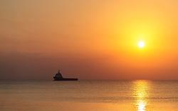 THEMENBILD - ein Schiff am Mittelmeer bei Sonnenaufgang an einem heissen Sommertag, aufgenommen am 17. August 2018 in Larnaka, Zypern // a ship on the Mediterranean Sea at sunrise on a hot summer day, Larnaca, Cyprus on 2018/08/17. EXPA Pictures © 2018, PhotoCredit: EXPA/ JFK