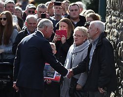 The Prince of Wales (left) is greeted as he arrives for a visit the Aberfan Memorial Garden in Wales, on the 50th anniversary of the Aberfan disaster.