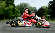 Cassidy Callahan, 10, sits in her Yamaha go-kart at her home in Penfield, NY, Tuesday, August 12, 2014. Callahan races her go-kart every Sunday. <br /> (Heather Ainsworth for The New York Times)