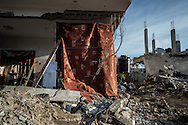 Families are living in the rubble of their habitation