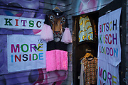 Kitch tiger face dress for sale at one of the vintage fashion clothes shops along Brick Lane, London, UK.
